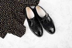 Flat lay style of spring or autumn black shoes and clothes with polka dots. Flat lay, top view royalty free stock images