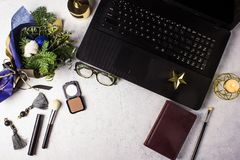 Flat lay styled office desk with laptop, winter bouquet with Nobilis pine branches, cosmetics, accessories royalty free stock image