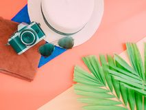 Flat lay for summer background with palm leaf , camera and beach stock images