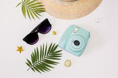 Flat lay summer beach holiday accessories on white background with palm leaf, straw hat and and sunglasses. Space for text. Travel and beach vacation, top view stock photos