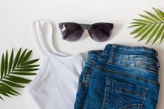 Flat lay summer beach holiday accessories on white background with palm leaf, straw hat and and sunglasses. Space for text. Travel and beach vacation, top view royalty free stock photos