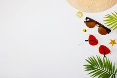 Flat lay summer beach holiday accessories on white background with palm leaf, straw hat and and sunglasses. Space for text. Travel and beach vacation, top view stock image