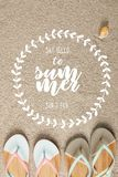 flat lay with summer flip flops and seashell on sand with 'say hello to summer ' lettering in floral frame stock photos
