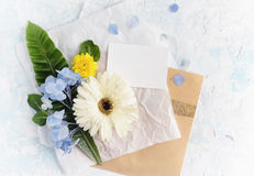 Flat lay summer flowers mock up with greeting card on craft pape Stock Image