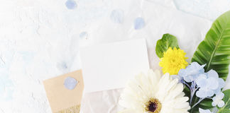 Flat lay summer tropical mock up with craft paper. Flat lay tropical flowers mock up with greeting card on craft paper. Romantic holiday background. Text space Stock Photography