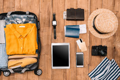Flat lay of summer vacation things neatly organized on wooden background Royalty Free Stock Photo