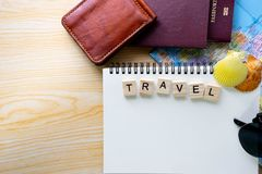 Flat lay summer words written on wooden scrabble block and trave stock photos