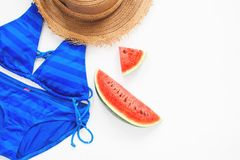 Flat lay of swimwear in blue color with watermelon, Summer Stock Photo