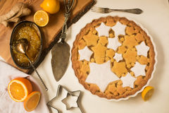 Flat lay tart with lemon, orange and ginger jam decorated with star-shaped cookies. Flat lay tart with lemon and orange, ginger jam decorated with star-shaped Royalty Free Stock Images