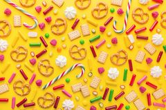 Sweets flat lay on yellow background stock images