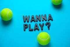 Free Flat Lay Tennis Balls And Inscription Wanna Play On A Bright Blue Background Royalty Free Stock Photography - 174947277