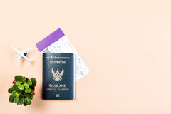 Flat lay of Thailand official passport, boarding pass, small cactus. Flat lay and copy space for design work of Thailand official passport, boarding pass, small Stock Photography