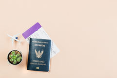 Flat lay of Thailand official passport, boarding pass, small cactus. Flat lay and copy space for design work of Thailand official passport, boarding pass, small Stock Photos