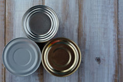 Flat lay of three tin cans in a shape of a pyramid Stock Photo