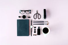 Flat lay, top view black style office table desk. feminine working supplies Royalty Free Stock Image