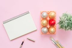 Flat lay top view colorful easter egg painted in pastel colors composition and mock up blank notebook with paint brush. Flat lay top view colorful easter egg Stock Images