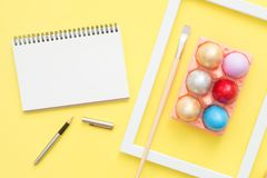 Flat lay top view colorful easter egg painted in pastel colors composition and mock up blank notebook with paint brush. Flat lay top view colorful easter egg Stock Photo