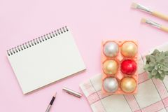 Flat lay top view colorful easter egg painted in pastel colors composition and mock up blank notebook with paint brush. Flat lay top view colorful easter egg Royalty Free Stock Photos