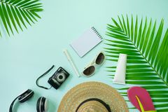 Flat lay top view with hat,pen,shoes headphone,camera,notebook a Royalty Free Stock Photos