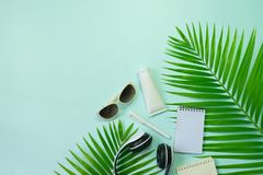 Flat lay top view with hat,pen,shoes headphone,camera,notebook a Royalty Free Stock Images