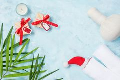 Free Flat Lay Top View Holiday Spa Background: Thai Massage Bag, Towels And Gift Boxes On Blue Background Royalty Free Stock Photography - 105684837