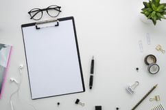 Home office desk workspace with office accessories on white background. Royalty Free Stock Images