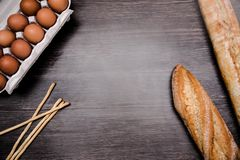 Flat lay top view of loaves of bread, sticks of bread an dozen of eggs. Copy space royalty free stock photos