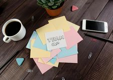 Flat lay, top view office table desk. Workspace with blank clip board, pencil, green leaf, and coffee cup on dark background. Flat lay, top view office table royalty free stock image