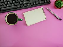 Flat lay office desk with copy space. Flat lay,top view pink office desk and coffee with copy space Royalty Free Stock Photo
