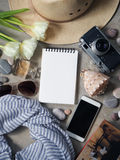 Flat lay, top view traveler`s notebook, hat sunglasses, camera, perfume Stock Images