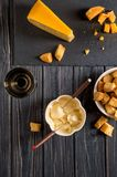 Flat lay. Traditional french cheese fondue. Crouton dipped into hot cheese fondue on a long-stemmed fork. stock image
