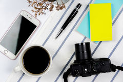 Flat lay travel concept with camera, mobile phone Royalty Free Stock Images