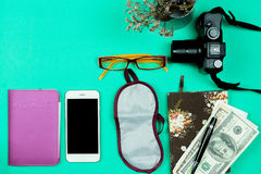 Flat lay travel concept with camera ,smart phone and bank note o Royalty Free Stock Photo