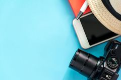 Flat lay travel concept with mobile phone,camera,book,hat Stock Photography