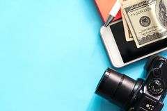 Flat lay travel concept with mobile phone,camera,dollar Royalty Free Stock Image