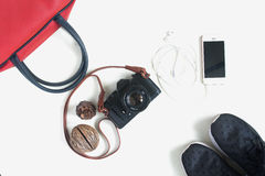 Flat lay of travel items with film camera, smartphone, red hand Stock Photo