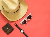 Flat lay traveler accessories on pink background with blank space for text. Top view travel or vacation concept. Summer stock photo