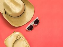 Flat lay traveler accessories on pink background with blank space for text. Top view travel or vacation concept. Summer royalty free stock photography