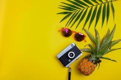 Flat lay traveler accessories on yellow background. Top view travel or vacation concept. Summer background stock photo