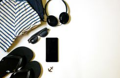 Flat lay traveler stuff on white background with blank space for text stock photo