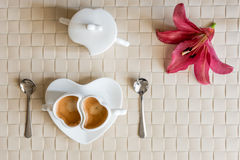 Flat lay with two cups of espresso coffee and flower Stock Photography