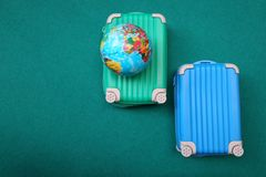 Flat lay two suitcase with a globe stock photos