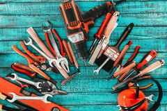 Flat lay with various carpentry equipment on blue. Wooden surface royalty free stock photography
