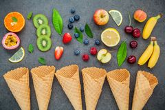 Flat lay various fresh fruits: raspberry, blueberry, strawberry, orange, banana, kiwi Royalty Free Stock Image