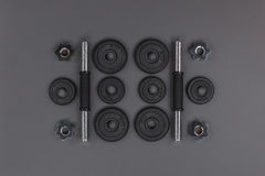 Flat lay with various metal barbells and weight plates Royalty Free Stock Photo