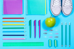 Flat lay with various school supplies on colorful surface Royalty Free Stock Photography