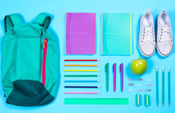 Flat lay with various school supplies on colorful surface Royalty Free Stock Photos