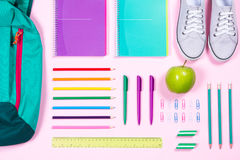Flat lay with various school supplies on colorful surface Royalty Free Stock Images