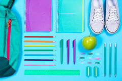 Flat lay with various school supplies on colorful surface Stock Photo