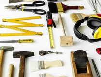 Flat lay of various technician tools isolated on white background Royalty Free Stock Images